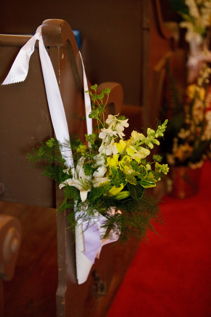 Little bouquets of flowers hung from every other pew The entire church