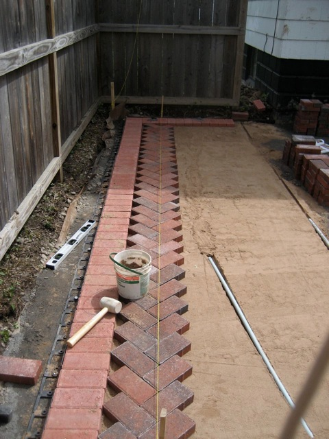 Patio bricks going down - Patio and Back Yard Reveal