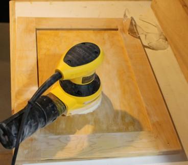 Sanding the cabinet doors