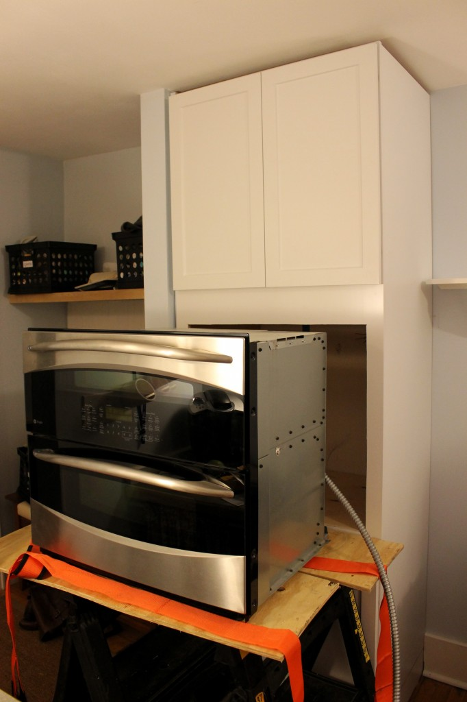 cabinet with oven out 682x1024 - We Installed Our New Oven!!!