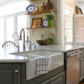 Rustic kitchen shelves over peninsula