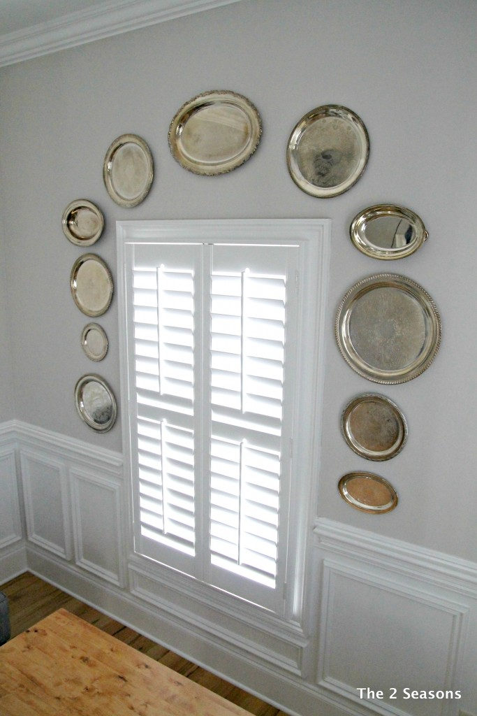 Silver trays on dining room wall