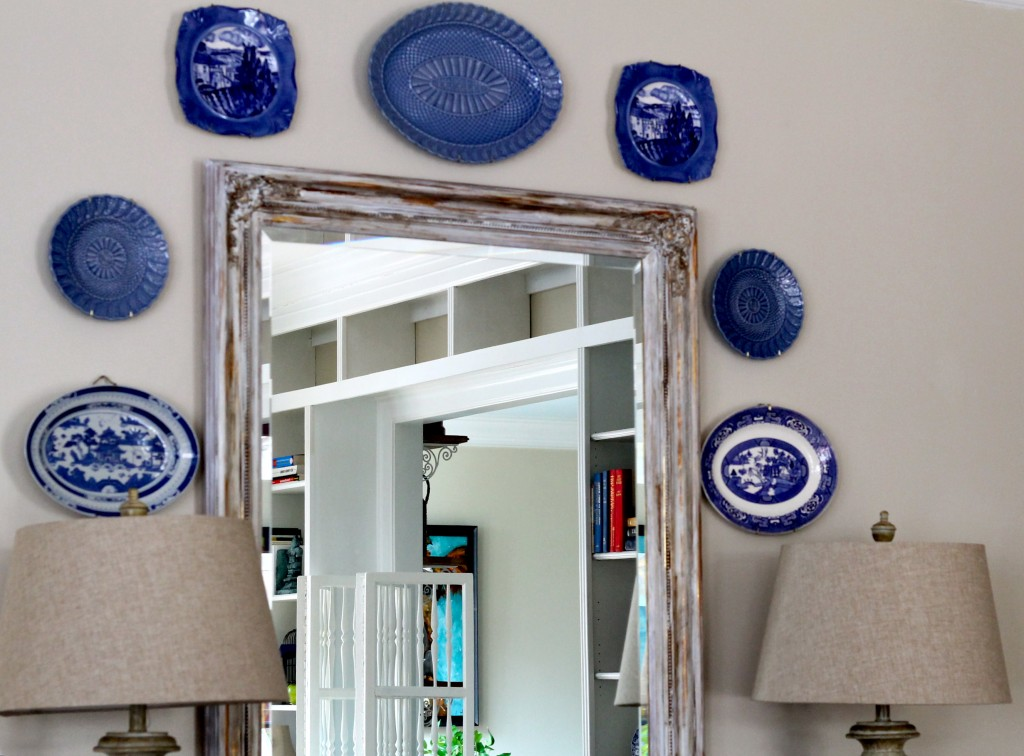 Blue plates add color to a neutral wall