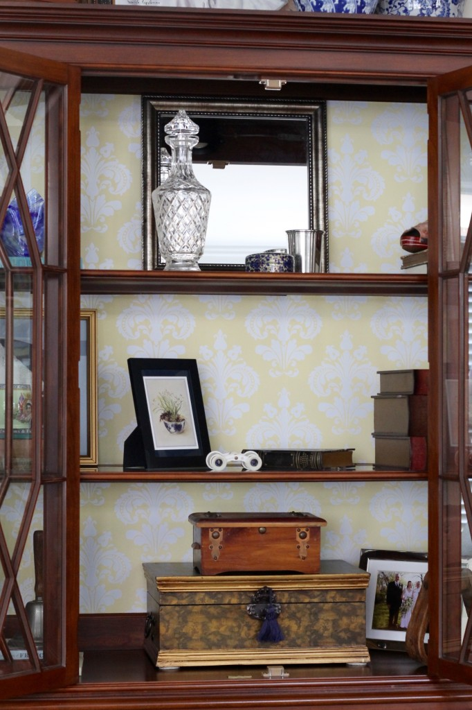 Wallpaper adds color to great room cabinet - The 2 Seasons