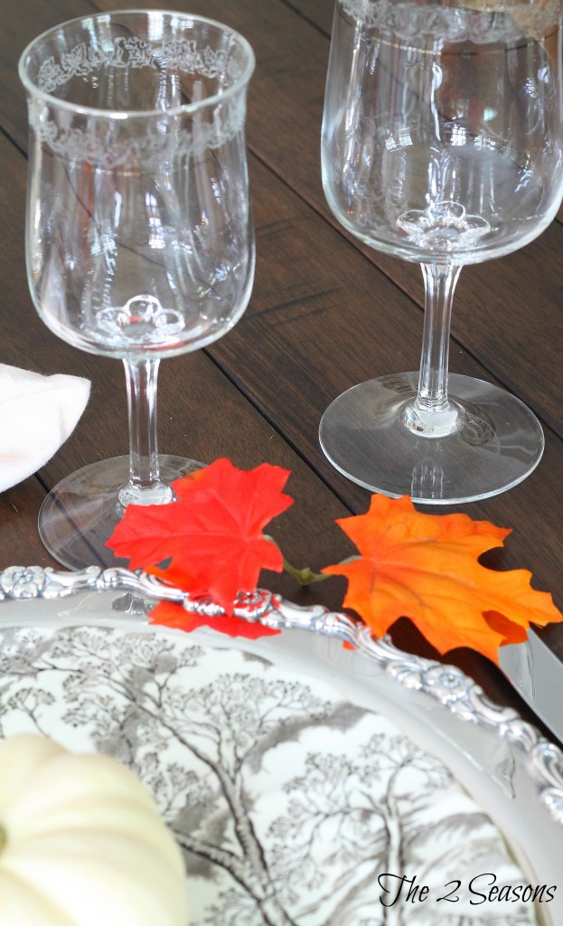 Use silver trays as chargers on your holiday table = The 2 Seasons