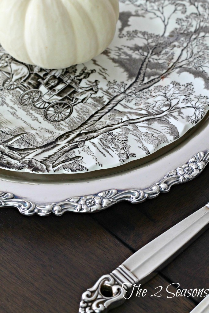 A great idea for your holiday table is to use silver trays as chargers - The 2 Seasons