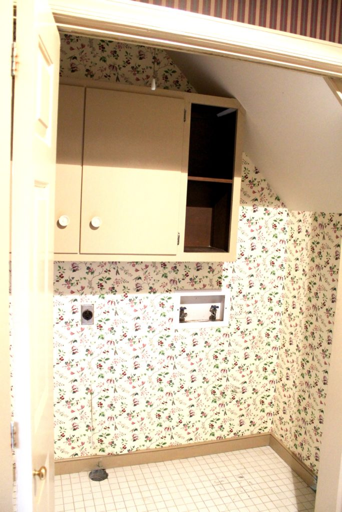Townhouse laundry room before - The 2 Seasons