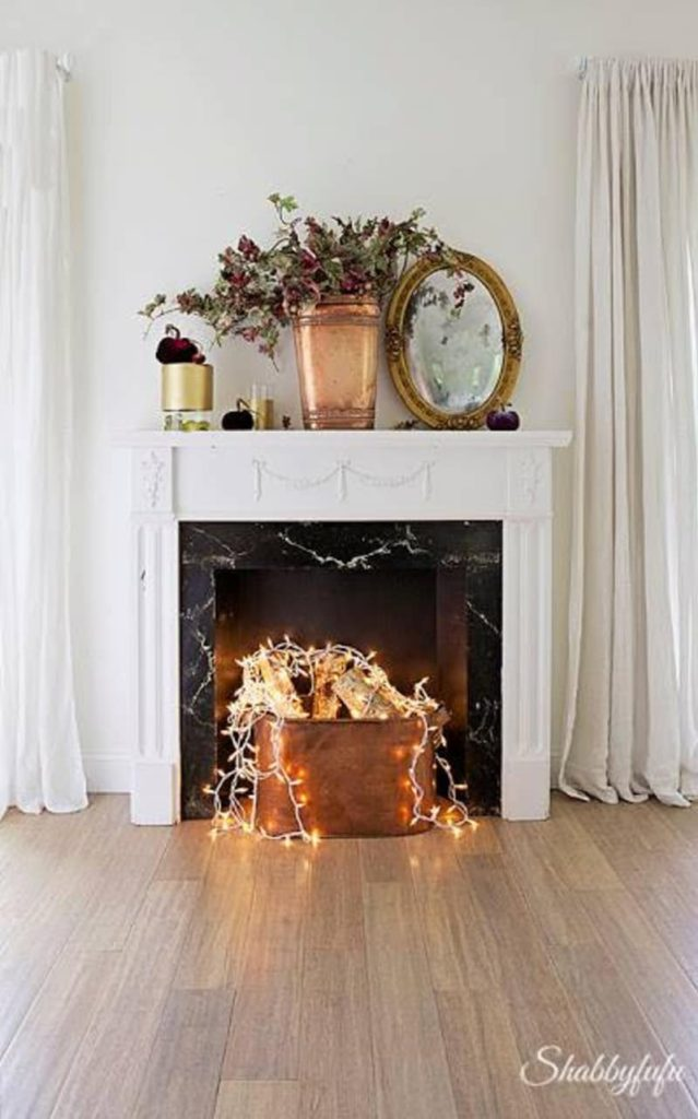 Fake a fireplace 639x1024 - How to Decorate a Blank Wall